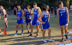 The boys varsity team surveys their opponents and stretches before their center meet. Pictured here are captains Samuel Forbes (12) and Alex Kwok (12).