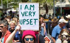 Woman hits the streets to declare that she is very upset.
