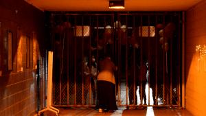 Irvington Principal Nathania Chaney-Aiello holds back late entrants at the Victory Tunnel entrance.