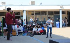 Dylan Lee (11) sings a cover of Lemon by Kenshi Yonezu at the during FLEX as other students listen.