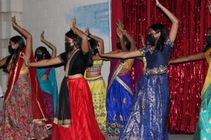 IndoPaks Natya team is pictured performing on stage during Bollywood Night